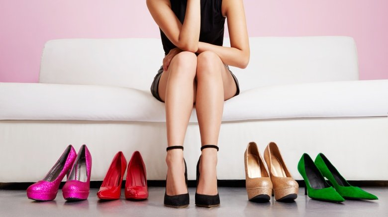 Girl choosing high heels to wear