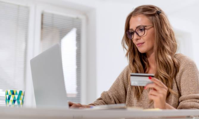 Girl buying online with security