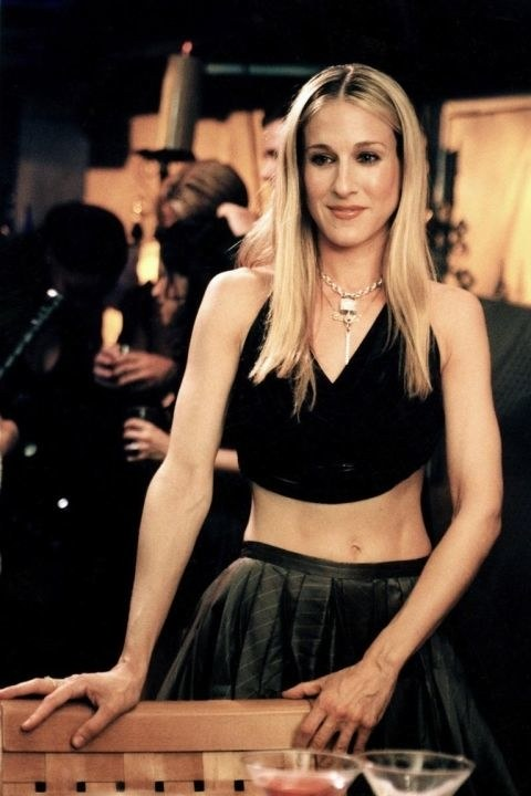 Carrie Bradshaw wearing a black crop top