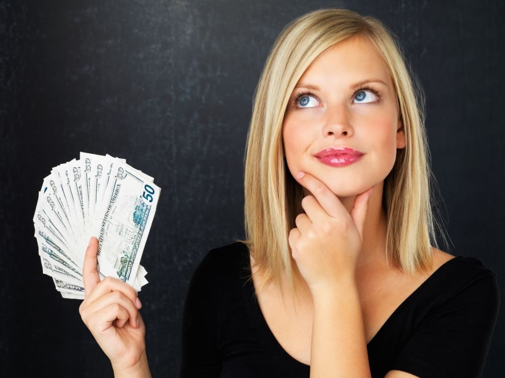 Girl thinking about her budget for going shopping